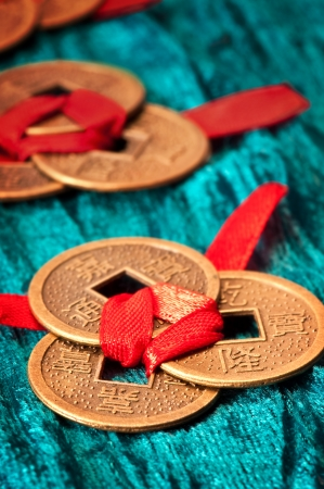 Chinese lucky coins tied with red ribbon photo