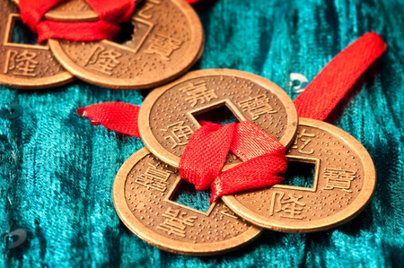 Close-up of Chinese lucky coins tied with red ribbon