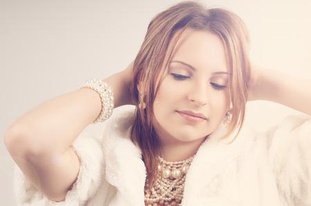 Beautiful woman wearing pearls daydreaming Stock Photo