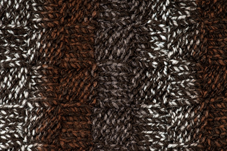 acrylic yarn: Close-up of hand knitted striped fabric, made with acrylic and wool mix chunky yarn. Great for craft background.