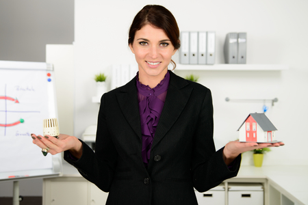 turn about: beautiful business  woman worry about heating costs in office