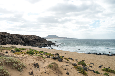 Sea view with mountains, clouds and rocks, Lanzarote Imagens