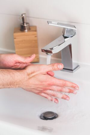 Hand washing with soap in bathroom to prevent contaminate, close up Standard-Bild
