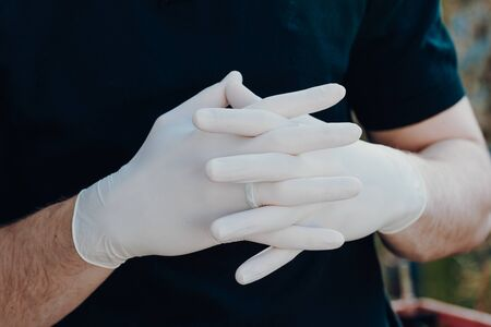 Man wearing gloves for protection from virus