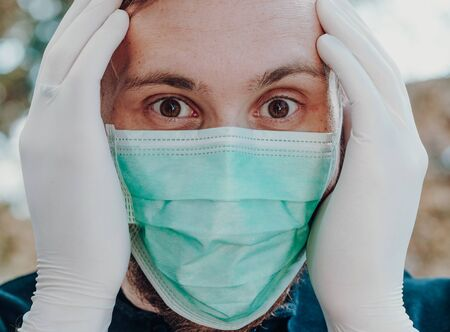 man wearing face mask and gloves to prevention of contamination, close up, outdoor