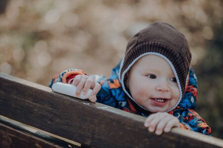 portrait of cute infant, smiles, close up, outdoor