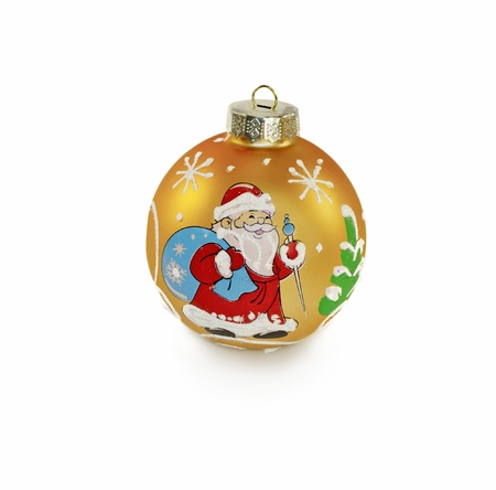 depicts: The photo shows a one yellow decorative ball for Christmas tree decoration, isolated on white background  On the toy depicts Santa Claus with a bag of gifts  Stock Photo