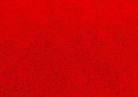 origen animal: La foto muestra el fondo rojo con textura y patrones de piel natural de origen animal