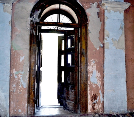forsaken: element of the interior of an abandoned, old building. The photo shows part of the hall and open the door.