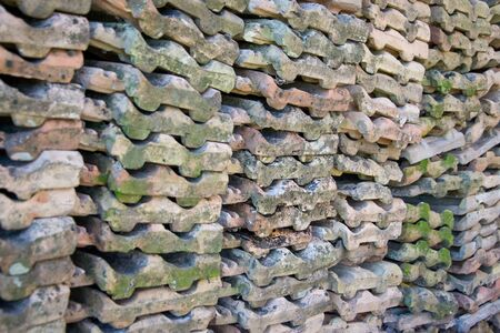 Roof tiles arranged on a wall, rural scene, pattern