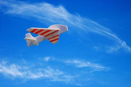 unworried: Kite Airplane on blue sky Stock Photo