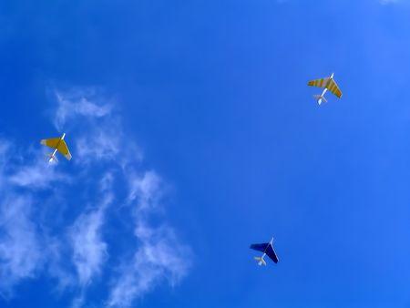 Kite Airplanes on blue sky photo