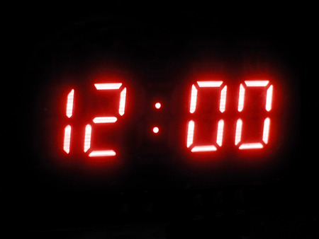 microwave oven: LCD display showing 12:00 Stock Photo