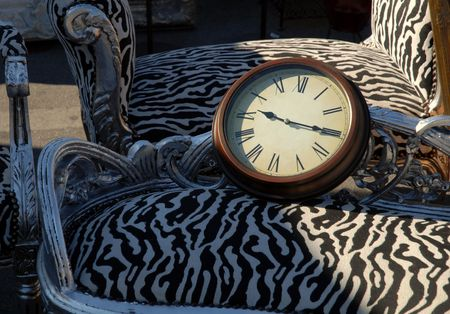 wall clock: Wall clock on old chair
