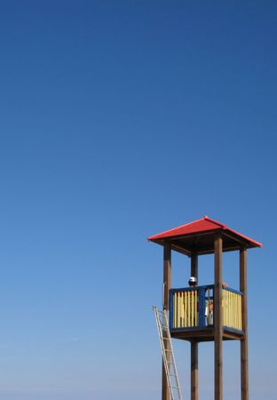 lifeguard tower: Lifeguard Tower on blue sky. Copyspace on left and top