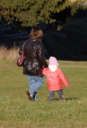 fostering: Mother and Child walking in a meadow