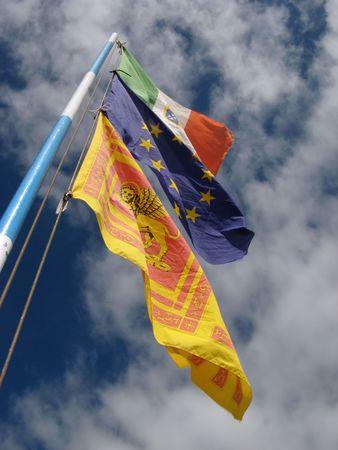 eec: Waving Flags on cloud sky (Italian,European,Venetian Flags) Stock Photo