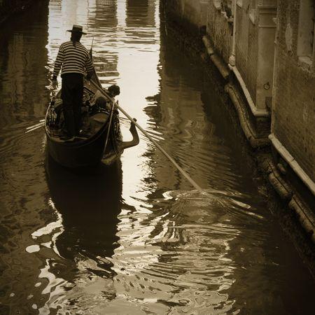 italian sea: Gondola along a venetian canal