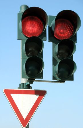 red traffic light: Red traffic light and give place sign.
