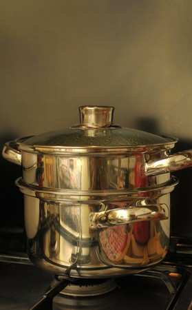 Steam vegetable cooking: stacked pots photo
