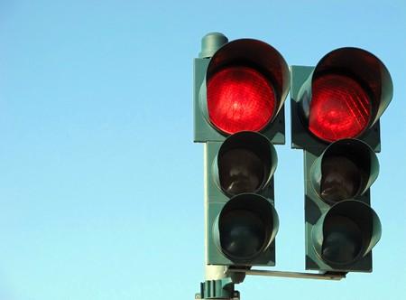 red traffic light: Red traffic light over blue sky