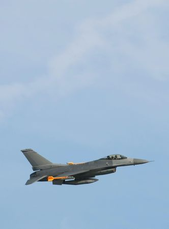 f 16: Military jet: No corp insignas nor flags,marks,numbers are visible