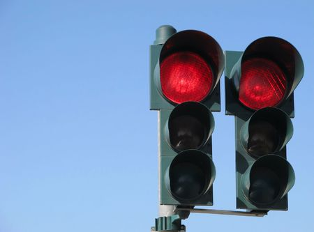 red traffic light: Red traffic light on sky Stock Photo