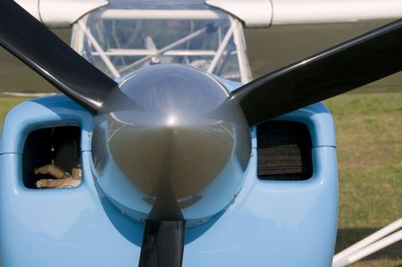 Parked prop airplane detail photo