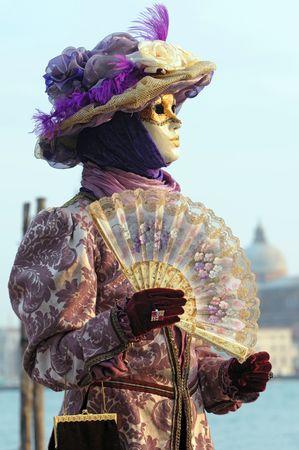enact: Venice carnival mask posing along St.Mark promenade Stock Photo