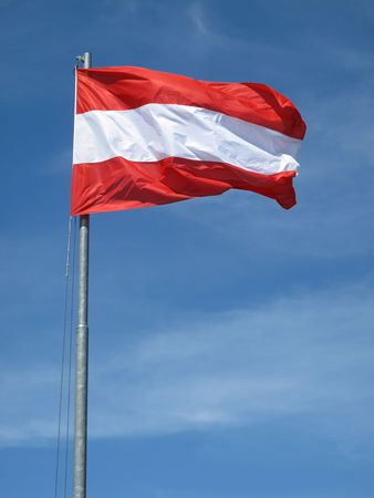 Waving Austrian flag on natural sky               Stock Photo