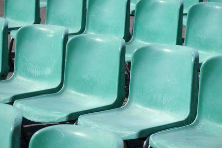 bleachers: Weathered bleachers plastic seats in a stadium