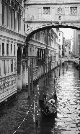 Gondola trip under Sospiri bridge
