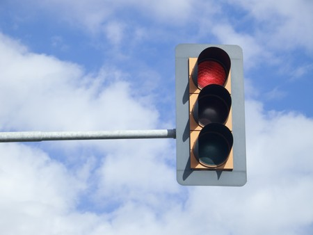Red traffic light on sky Stock Photo
