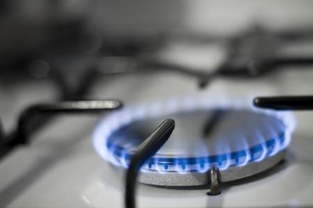 Burning gas in a kitchen stove photo