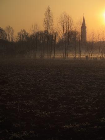 Sunrise over misty fields Stock Photo - 8737393
