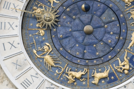 Zodiacal wall clock Stock Photo