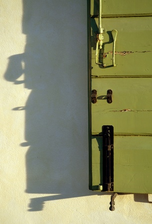 Italian shutter and shadow abstract photo