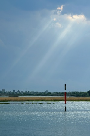relaxant: Sunbeams over lagoon Stock Photo