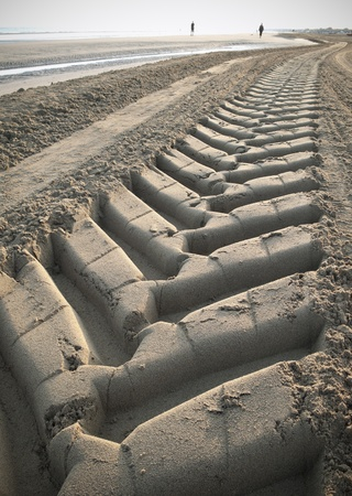 Tractor trail on the beach photo