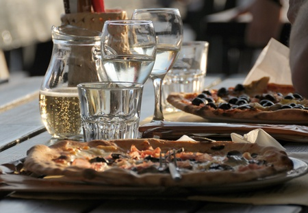 Pizza and wine in an outdoor restaurant