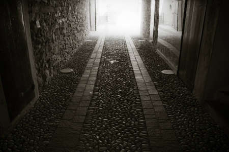 light at the end of the tunnel: Cobblestone paving in an urban gallery