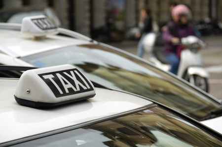 Taxi sign on an urban cab Stock Photo
