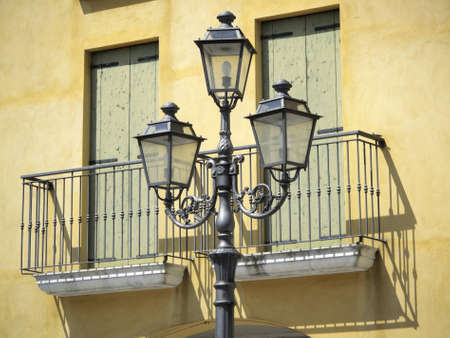 Old style streetlight and house facade photo