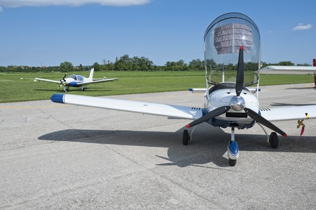 aircraft engine: Light aircraft parked with opened canopy