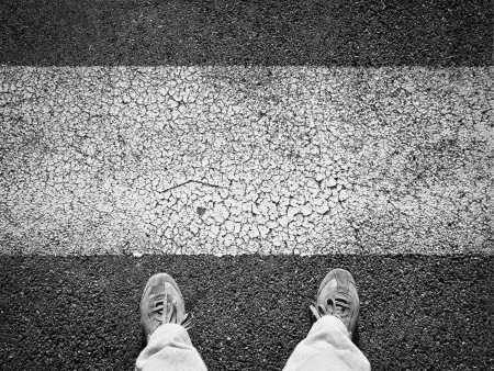 Zebra crossing and pedestrian feet photo
