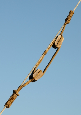 pulleys: Old rigging and wooden pulleys on a vessel Stock Photo
