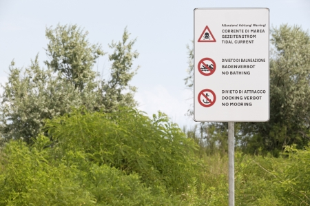 forbidding: Warning and forbidding signs in a natural state coastal environment