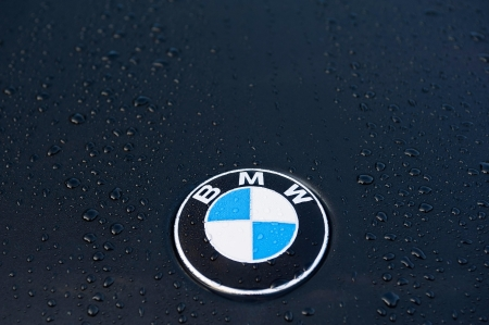 Padua, Italy - July 6, 2011: Circle shape BMW logo and part of the front grill on a black BMW (3 Series) car. BMW is a German automobile manufacturer. Shot in a public parking in Padua, Italy. Stock Photo - 16746074