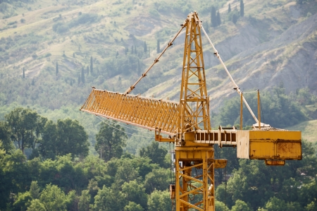 counterbalance: Building crane with hills on background
