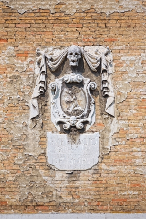 Ancient relief on a church wall in Venice, Italy Stock Photo - 17097800